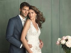 We love this lace sheath gown.  Give it a repin.  Available at www.gatewaybridal.com