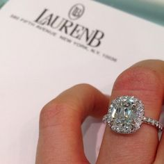 Cushion cut diamond with a matching halo. This is how a halo should be. (I hate round stones with a cushion halo.)