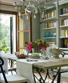 gorgeous dining room.  love the iron table and bookcases...