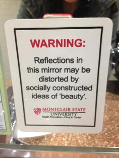 "WARNING: Reflections in this mirror may be distorted by socially constructed ideas of ""beauty"".  (Montclaire State University)"