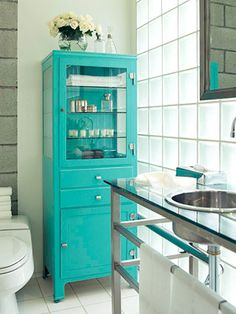 pop of color- turquoise. love the hidden storage and the glass display equal balance