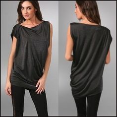 """DVF Petalina tunic or Mini dress In perfect condition this dark gray easy to wear tunic.  It can be worn as a mini dress.  It ha an asymmetrical hemline.  Size P in DVF or XS.   35.5"""" long at the longest point. Diane von Furstenberg Tops Tunics"""