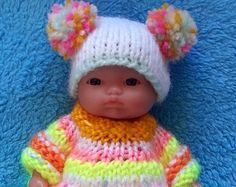 3-piece hand knitted Outfit for 5 Berenguer Doll  (will fit most dolls of similar size)  Hand-knitted with great care and love from high quality yarn  Comprising of top, trousers and hat  From smoke free home  The doll is NOT included