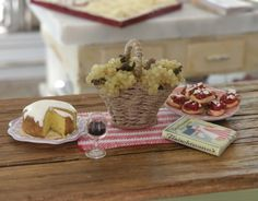 Red Gingham Rooster Plate and miniature cookbook by Carrie Lavender, Alavenderdilly. Miniature setting by Cynthia's Cottage Design: Tuscan Kitchen - Bel Sole