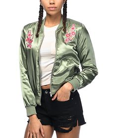Let your fierce side out with the Double Floral satin bomber jacket from Almost Famous. An olive colorway features a cluster of embroidered pink roses at each side of the chest and finished off with a full silver metal zipper.