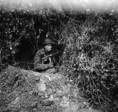 An American soldier in a foxhole near the front lines, during the Battle of the Bulge - December 1944