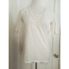 {j. crew} white lace bib tee Beautiful white loose fit elbow tee from J. Crew retail. Flattering and pretty. Pair with skinny jeans for a casual look or tuck into an a-line skirt for work!  Size xs. 60% cotton 40% polyester. Gently worn. J. Crew Tops Tees - Short Sleeve