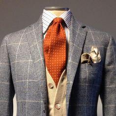 Windowpane blazer with creme waistcoat and orange tie