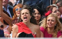 Go on! A lady roars her horse home to victory during the second race of Ladies' Day at Ain...