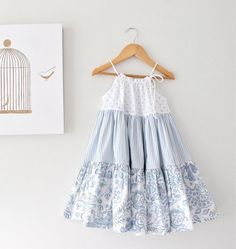 Cute dress, nice mix of patterns in pale blue