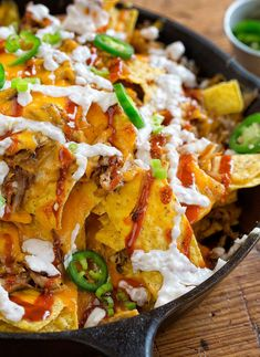These Pulled Pork Nachos are an appetizer favorite around here, besides that they are packed with flavor and pull together in minutes! Pulled Pork Nachos Pulled Pork Nachos are a family favorite around here. Slow Cooked Pulled Pork, Pulled Pork Nachos, Pulled Pork Recipes, Meat Recipes, Mexican Food Recipes, Cooking Recipes, Skillet Recipes, Cooking Tools, Nacho Recipes