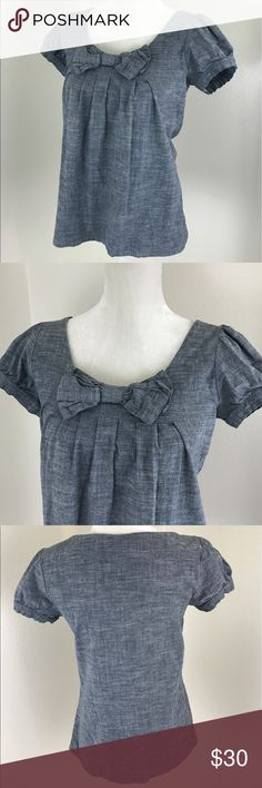 Anthro Fei Chambray Bow Short Sleeve Pleat Blouse Anthropologie Fei blue denim chambray pleated short sleeve Blouse with bow on the front. Lightly used condition. Stretch material, spandex cotton blend. Armpit to armpit: 17.5 inch Length from back collar: 25 inches Anthropologie Tops Blouses
