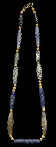 A ROMAN GLASS BEAD NECKLACE  CIRCA 1ST-2ND CENTURY A.D.  Composed of five twisted blue beads and one yellow, five marbled beads of green, blue and white, and one mosaic bead of green, white and purple, interspersed with modern gold beads; strung with a modern S-hook closure 2½ in. (57.2 cm.) long