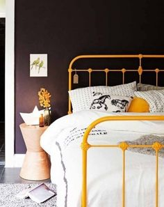 Yellpw bed & black wall!