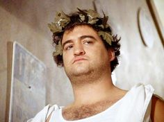 """John Belushi as Bluto. The movie """"Animal House"""" (National Lampoon's Animal House), directed by John Landis. Seen here, John Belushi (as 'Bluto' Blutarsky) during fraternity toga party."""