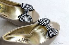 Dress your shoes with this pair of black and white gingham bows. $17.63
