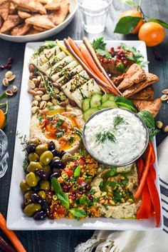 MLoaded up with hummus baba ganoush marinated feta tzatziki tomato rice salad muhammara zaatar pita chips sliced veggies and nuts this mezze platter is the perfect spread of Mediterranean and Middle Eastern flavors. Party Platters, Catering Platters, Catering Display, Party Trays, Catering Food, Healthy Dinner Recipes, Appetizer Recipes, Cooking Recipes, Medeteranian Recipes