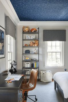 Transitional kids room showcases a constellation from Ralph Lauren Constellation Wallpaper on the ceiling. The room is designed with a brown wood desk, a caramel leather chair, and an industrial-leaning bookshelf. Look Wallpaper, Wallpaper Ceiling, Kids Room Wallpaper, Wallpaper Designs, Brown Wallpaper, Star Wallpaper, Galaxy Wallpaper, Wallpaper Ideas, Boy Toddler Bedroom