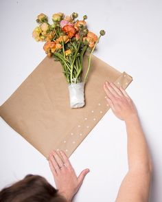 Cut flowers wrapped in kraft waxed tissue paper and tied with olive so youre heading to a dinner and want to bring a fresh bouquet of flowers you picked up at the farmers market yesterday theyve been sitting in water at mightylinksfo