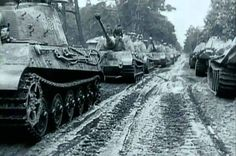 KingTiger  of the heavy tank division 503 on the return from the well-known Royal Parade Sennelager, September 25, 1944, at Paderborn, the tanks carry all the loading tracks  because it goes in October to Hungary, Budapest .... right see as new Panther to the one new raised unit ..