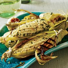 """Butter is not the villain it once was,"" says Michel Nischan, who adds a little bit to roasted garlic to create a rich, creamy spread for corn on the ..."