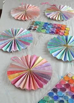 Paper pinwheels made to be painted as a birthday party craft.