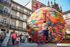 You Can Actually Spin Inside of Portugal's Latest Art Installation Step inside of this colorful orb to experience one of the Portugal's most whimsical feats in artistic design - Architercture Digest - August 2016