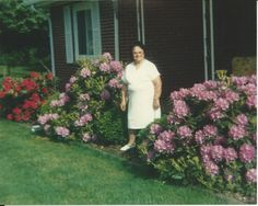 Always planting flowers to make things look pretty, you took pride in your home. Your example taught us to care for our own homes because they're a reflection of the people who live there. Own Home, How To Look Pretty, Planting Flowers, Reflection, Pride, White Dress, Homes, People, Plants