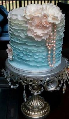 Ombre style wedding cake. Ivory, seafoam, mint and tiffany blue. Added touches of blush and ivory with the flowers and pearls.  ♥