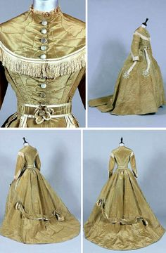 Olive green-brown moiré silk afternoon gown, ca. 1865. Attached bodice has ivory satin bands & fringing. Large ovoid skirt adorned with plaited ivory satin bands & floral rosettes, glass buttons that fasten, with matching belt. Kerry Taylor Auctions/Invaluable