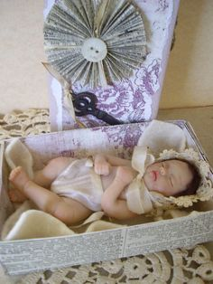 I hand sculpted baby Eloise from polymer clay. This sweet doll sleeps in a cozy altered matchbox!  http://www.ebay.com/itm/170881185192?ssPageName=STRK:MESELX:IT&_trksid=p3984.m1555.l2649