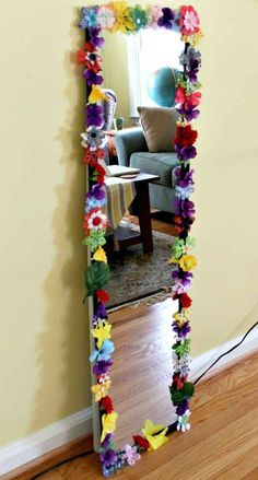 Spruce up an old mirror using fake flowers and a glue gun.