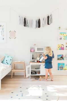 Simple, minimalist baby and toddler shared kids' room. So sunny and bright and cheerful!