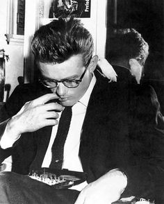 James Dean playing chess with a parakeet on his shoulder.