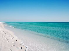 The brilliant color of the clear water at Seaside, Florida - especially on calm days - heightens the almost dream-like atmosphere of this stretch of Florida's Emerald Coast.
