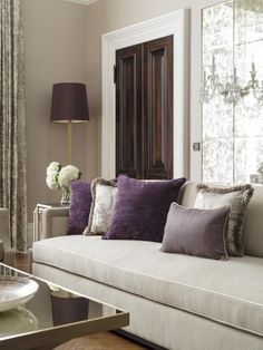 Formal living room with bespoke sofa in Kensington mansion