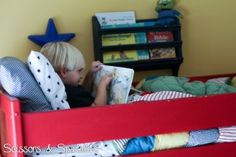 """Back in December we moved the boys into the same room and they got bunk beds for Christmas. I'm sure you've all seen these wall hanging book bins on Pinterest and maybe even in the Land of Nod catalog, which is where I got the idea. They call them """"Bin There Done Book Bin"""" and they cost $69 each!"""