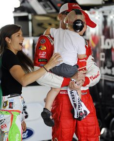 Driver Danica Patrick plays with Kevin Harvick's son, Keelan, as they prepare for practice for Sunday's NASCAR Sprint Cup sereis auto race, Saturday, Nov. 15, 2014 in Homestead, Fla