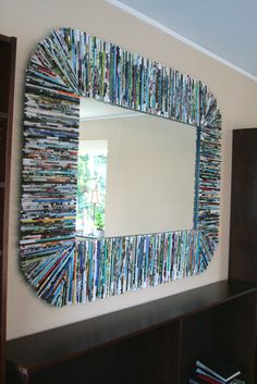 Recycled Magazines as Mirror Frame  I don't know if I'll ever have the patience to do this, or the storage box done in the same style, but I love the look.  http://www.bluevelvetchair.blogspot.com/2011/11/tutorial-recycled-magazines-as-mirror.html#