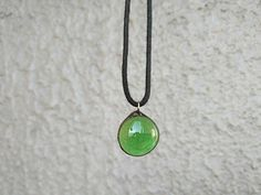 Green glass and metall pendant. Stained-glass window style.