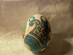 Another brown chicken egg that wound up unbrowned.  Etched, hand-painted dyes…
