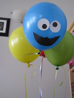 Cut out faces use construction paper and tape to balloons