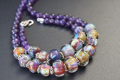 Handmade glass beads, amethyst, silver.
