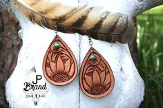 Hand tooled leather earrings $43 https://www.etsy.com/shop/JPBrand