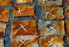 Detail of a piece called Rust Moon by Velma Bolyard. Layers of handmade daylily paper, linen, hosta and shifu.