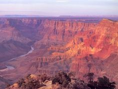 """Grand Canyon"" -- One of the world's most spectacular natural spectacles. Created thorugh millions of years of natural erosion that features majestic rock walls over a mile high at its deepest and spans across over 18 miles at its widest. Millions of visitors each year travel to Arizona to experience this amazing geological formation in person."
