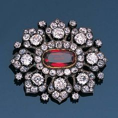 Spinel and Diamond Brooch/Pendant - c. 1890 - oval mixed-cut red spinel - petal-shaped border of cushion-shaped, old brilliant and single-cut diamonds - mounted in silver and gold Jewelry Art, Jewelry Gifts, Jewelery, Fine Jewelry, Jewelry Design, Effy Jewelry, Gold Jewelry, Antique Brooches, Antique Jewelry