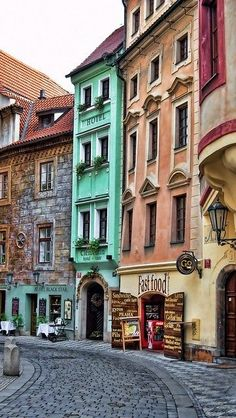 Prague, Czech Republic. Love the contrasting spring colors of cool sea green and warm sunset colors that are dispersed on this street