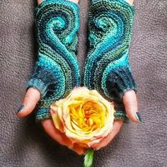 A swirling stitch design combined with a lovely variegated color palette create the Swan's Head Mitts. This beautiful fingerless mittens knitting pattern is knit in one piece beginning at the thumb. The shape of the swan's head is achieved by increasing the first part of a row and decreasing the second part, giving the pattern a figure-eight design.