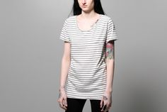 """torque tee stripe - Ultra soft short sleeve jersey tee in black and off white stripes. Cut against the grain with slight cowl and a curved, unfinished hem and pocket detail. Unisex.    Model wears size S - 18.5""""W x 27.5""""L (front) 29.5""""L (back)    100% cotton    Made in USA"""